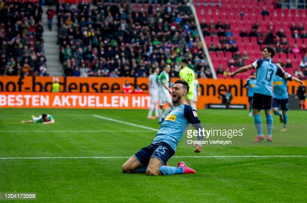 Ramy Bensebaini of Borussia Moenchengladbach celebrates after scoring the first goal of his team during the Bundesliga match between FC Augsburg and...