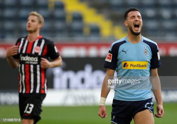 Ramy Bensebaini of Borussia Moenchengladbach celebrates after scoring his sides third goal from a penalty during the Bundesliga match between...