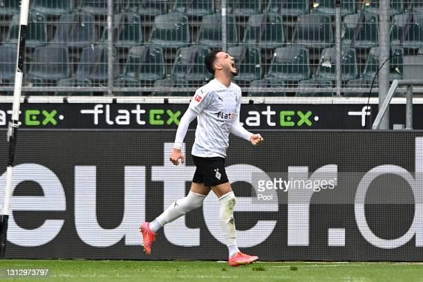 Ramy Bensebaini of Borussia Moenchengladbach celebrates after scoring their team's third goal during the Bundesliga match between Borussia...