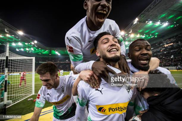 Ramy Bensebaini of Borussia Moenchengladbach celebrates with teammates after scoring their second goal during the Bundesliga match between Borussia...