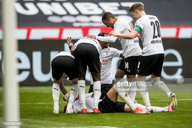 Ramy Bensebaini of Borussia Moenchengladbach celebrates with teammates after scoring their team's third goal during the Bundesliga match between...