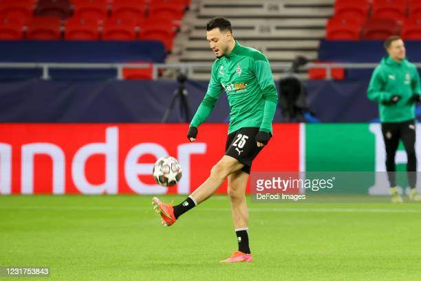 Ramy Bensebaini of Borussia Moenchengladbach controls the ball during the UEFA Champions League Round of 16 match between Manchester City and Bor....
