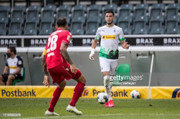 Ramy Bensebaini of Borussia Moenchengladbach in action during the Bundesliga match between Borussia Moenchengladbach and 1 FC Union Berlin at...