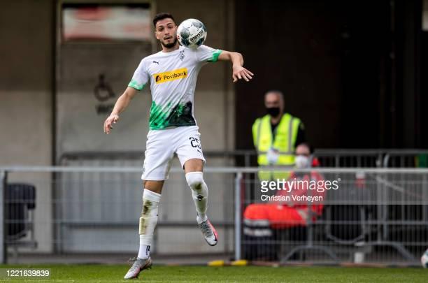 Ramy Bensebaini of Borussia Moenchengladbach in action during the Bundesliga match between SC Paderborn and Borussia Moenchengladbach at...