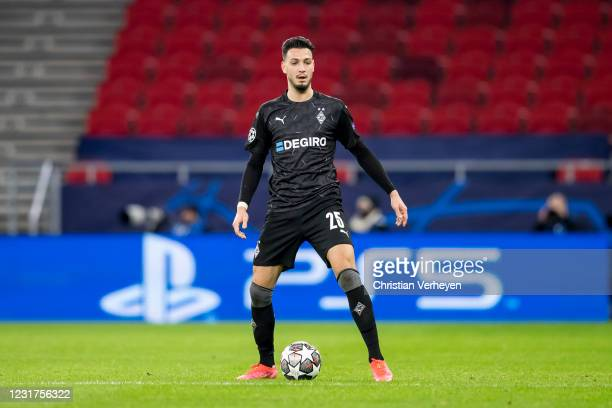 Ramy Bensebaini of Borussia Moenchengladbach in action during the UEFA Champions League Round Of 16 Leg Two match between Manchester City and...