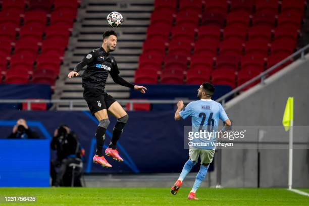 March 16: Ramy Bensebaini of Borussia Moenchengladbach in action during the UEFA Champions League Round Of 16 Leg Two match between Manchester City...