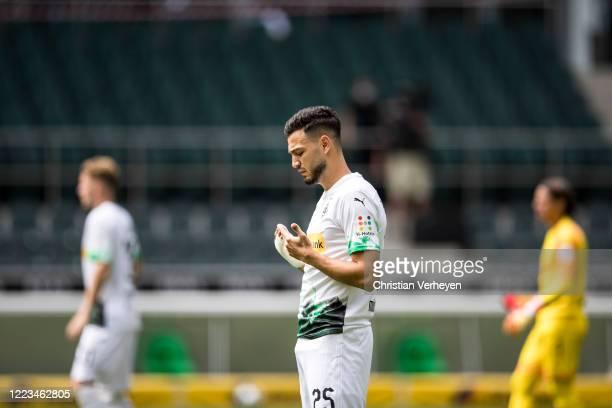MOENCHENGLADBACH GERMANY JUNE Ramy Bensebaini of Borussia Moenchengladbach prays ahead the Bundesliga match between Borussia Moenchengladbach and...