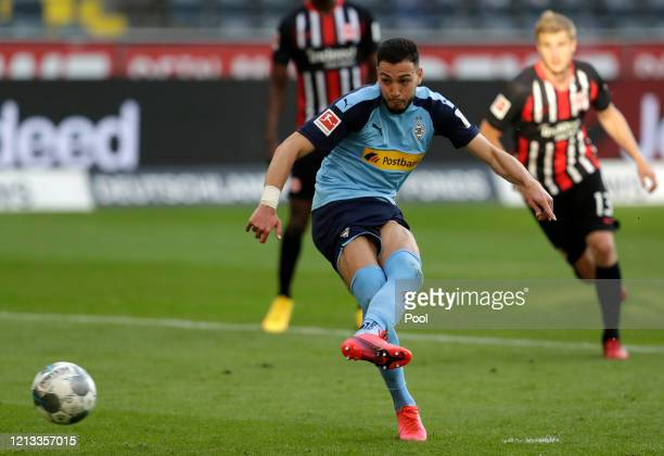 Ramy Bensebaini of Borussia Moenchengladbach shoots a penalty to score his sides third goal during the Bundesliga match between Eintracht Frankfurt...