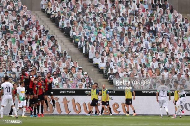 Ramy Bensebaini of Borussia Moenchengladbach takes a freekick during the Bundesliga match between Borussia Moenchengladbach and Hertha BSC at...