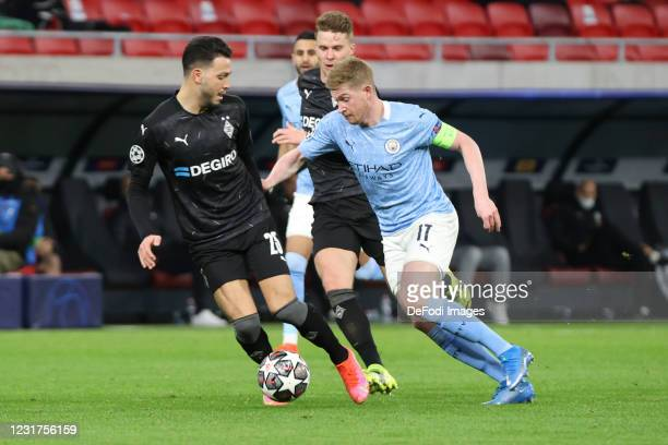 Ramy Bensebaini of Borussia Moenchengladbach udn Kevin De Bruyne of Manchester City battle for the ball during the UEFA Champions League Round of 16...