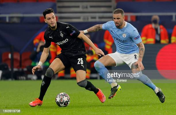 Ramy Bensebaini of Borussia Monchengladbach battles for possession with Kyle Walker of Manchester City during the UEFA Champions League Round of 16...