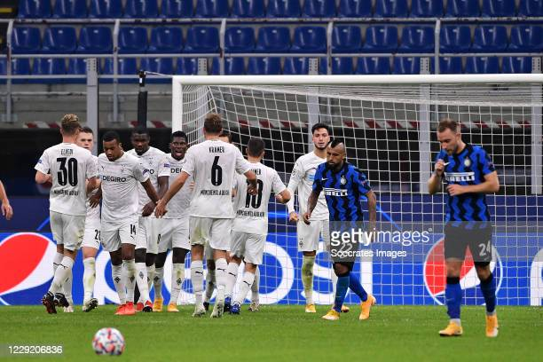 Ramy Bensebaini of Borussia Monchengladbach celebrates 11 with Jonas Hofmann of Borussia Monchengladbach Nico Elvedi of Borussia Monchengladbach...