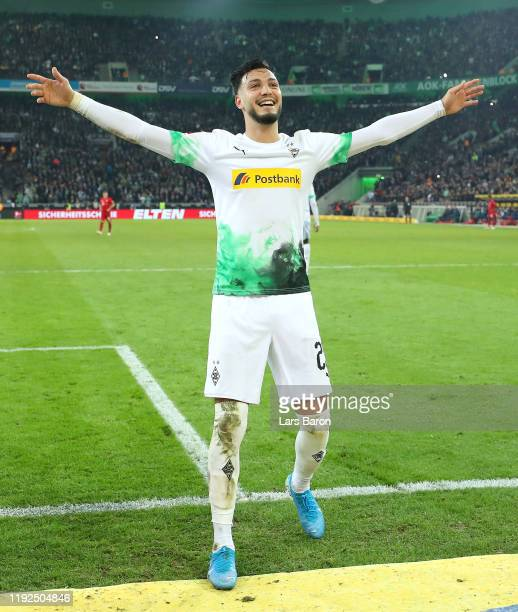 Ramy Bensebaini of Borussia Monchengladbach celebrates after scoring his team's second goal during the Bundesliga match between Borussia...