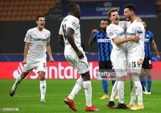 Ramy Bensebaini of Borussia Monchengladbach celebrates his goal with his teammates during the UEFA Champions League Group B stage match between FC...