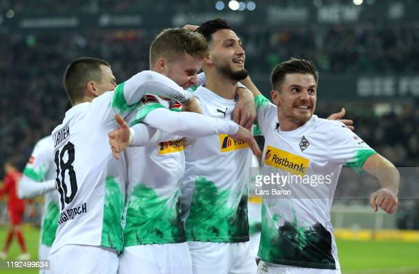 Ramy Bensebaini of Borussia Monchengladbach celebrates with his team mates after scoring his team's first goal during the Bundesliga match between...