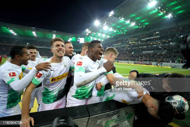 Ramy Bensebaini of Borussia Monchengladbach celebrates with his team mates after scoring his team's second goal during the Bundesliga match between...