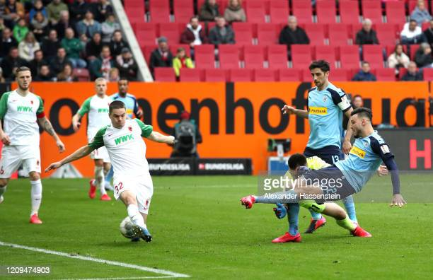Ramy Bensebaini of Borussia Monchengladbach scores his sides first goal during the Bundesliga match between FC Augsburg and Borussia Moenchengladbach...