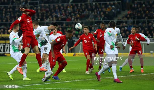 Ramy Bensebaini of Borussia Monchengladbach scores his team's first goal during the Bundesliga match between Borussia Moenchengladbach and FC Bayern...