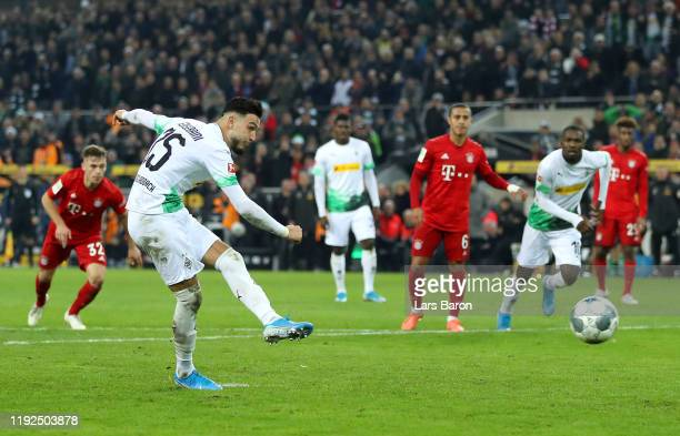 Ramy Bensebaini of Borussia Monchengladbach scores his team's second goal from the penalty spot during the Bundesliga match between Borussia...
