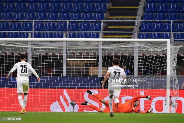 Ramy Bensebaini of Borussia Monchengladbach scores penalty by Samir Handanovic of Inter Milan during the UEFA Champions League match between...