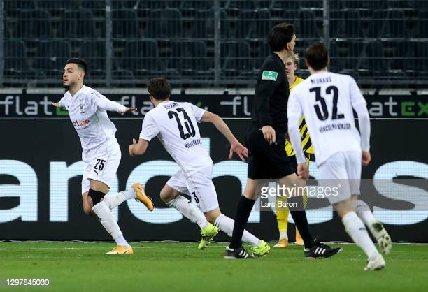 Ramy Bensebaini of Gladbach celebrates after he scores his team's 3rd goal during the Bundesliga match between Borussia Moenchengladbach and Borussia...