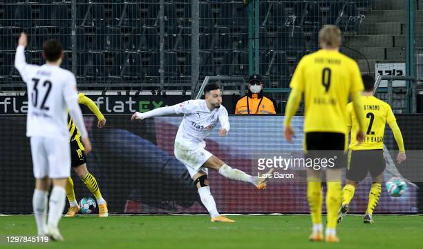 Ramy Bensebaini of Gladbach scores his team's 3rd goal during the Bundesliga match between Borussia Moenchengladbach and Borussia Dortmund at...