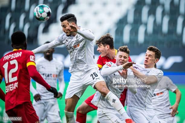 Ramy Bensebaini of Mönchengladbach heads the ball during the Bundesliga match between Borussia Mönchengladbach and Bayer 04 Leverkusen at...