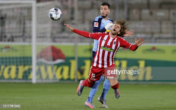 Ramy Bensebaini of Moenchengladbach and Lucas Hoeler of Freiburg in action during the Bundesliga match between SportClub Freiburg and Borussia...