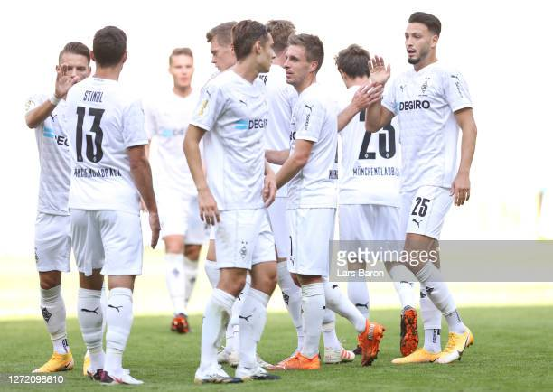 Ramy Bensebaini of Moenchengladbach celebrates his team's fourth goal with teammates during the DFB Cup first round match between FC Oberneuland and...
