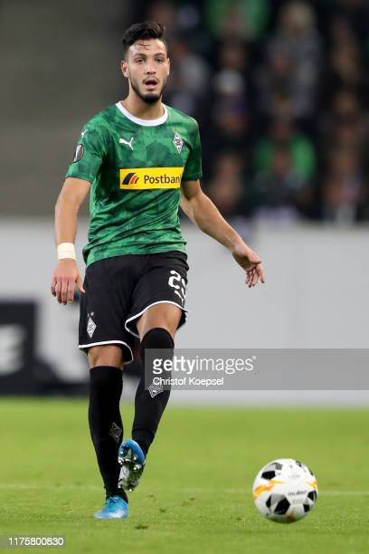 Ramy Bensebaini of Moenchengladbach runs with the ball during the UEFA Europa League group J match between Borussia Moenchengladbach and Wolfsberger...