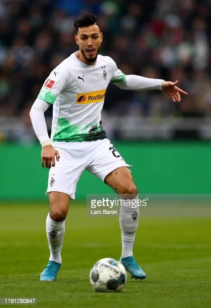 Ramy Bensebaini of Moenchengladbach runs with the ball during the Bundesliga match between Borussia Moenchengladbach and SportClub Freiburg at...