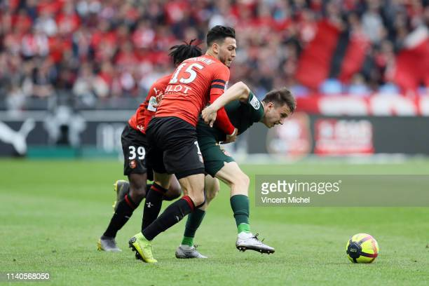 Ramy BENSEBAINI of Rennes and Aleksandr GOLOVIN of Monaco during the Ligue 1 match between Rennes and Monaco on May 1 2019 in Rennes France