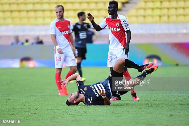 Ramy Bensebaini of Rennes is fouled by Adama Traore of Monaco during the French Ligue 1 match between AS Monaco and Stade Rennais at Louis II Stadium...