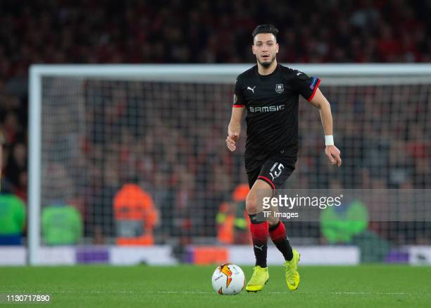 Ramy Bensebaini of Stade Rennes controls the ball during the UEFA Europa League Round of 16 Second Leg match between Arsenal and Stade Rennes at...
