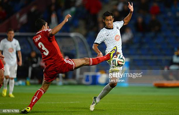 Ramy Rabia of Al Ahly challenges Severo Meza of Monterrey during the FIFA Club World Cup 5th place match between Al Ahly SC and CF Monterrey at...