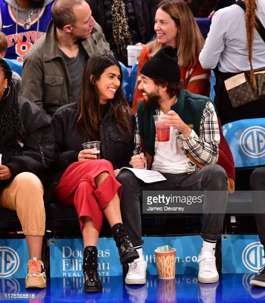 Ramy Youssef and guest attend New York Knicks v Washington Wizards preseason game at Madison Square Garden on October 11 2019 in New York City