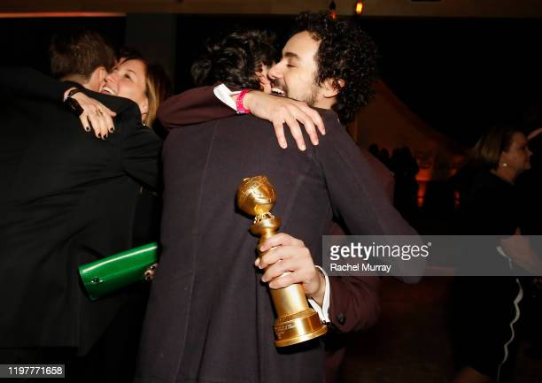 Ramy Youssef Golden Globe winner for Best Performance by an Actor in a Television Series Musical or Comedy is hugged by a guest the 2020 Walt Disney...