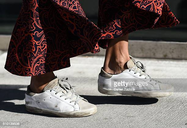 Ramya Giangola is seen outside the Tibi show wearing Golden Goose sneakers during New York Fashion Week Women's Fall/Winter 2016 on February 13 2016...