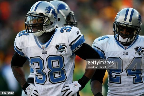 Ramzee Robinson and Kalvin Pearson of the Detroit Lions walk off the field during a game against the Green Bay Packers on December 28 2008 at Lambeau...