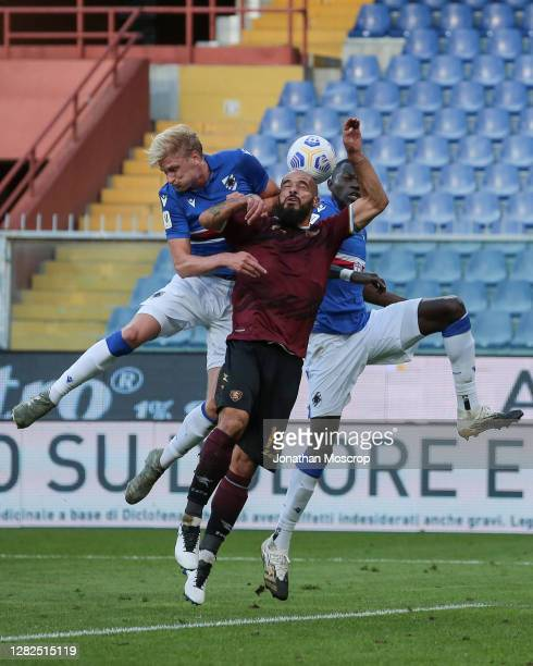 Ramzi Aya of Salernitana heads the ball clear under pressure from Morten Thorsby and Omar Colley of UC Sampdoria during the Coppa Italia match...