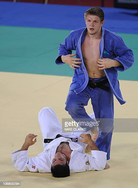 Ramziddin Sayidov of Uzbekistan fights Maxim Rakov of Kazakhstan in the men's 100kg category in the Judo quarterfinal on day one of the 16th Asian...