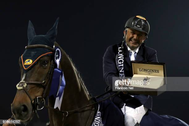 Ramzy Al Duhami of Saudi Arabia rides Ted while celebrating after winning at The President of the UAE Show Jumping Cup at Al Forsan on February 14...