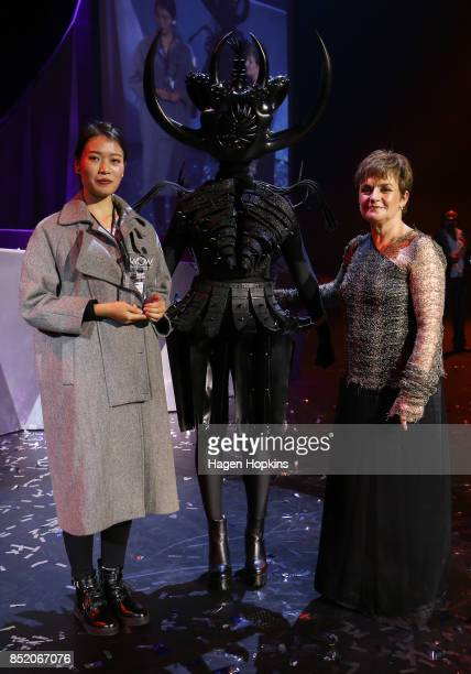 Ran Xu of China poses with her creation 'Cambrian Regeneration' and WOW CEO Gisella Carr after winning the Asia International Award during the World...