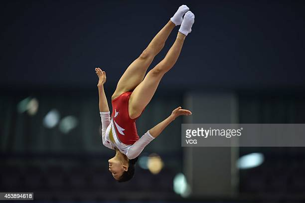 Rana Nakano of Japan competes in the Women's Individual Trampoline final match on day five of the Nanjing 2014 Summer Youth Olympic Games at Nanjing...