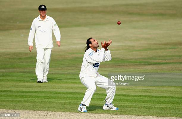 Rana Naved of Sussex catches Danny Briggs of Hampshire during the first day of the LV County Championship Division One match between Sussex and...