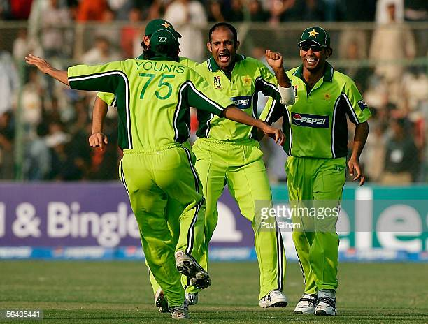 Rana NavedulHasan of Pakistan celebrates with with Mohammad Sami after taking the wicket of Vikram Solanki of England during the 3rd One Day...