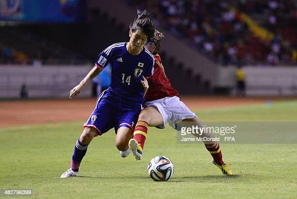 Rana Okuma of Japan battles with Nuria Garrote of Spain during the FIFA U17 Women's World Cup Final between Japan and Spain at Estadio Nacional on...