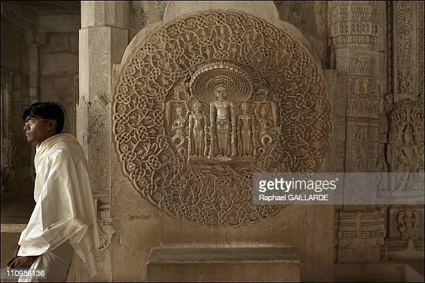 Ranakpur Twentythreeyearold Jain pilgrim Saurin Shah next to a magnificent marble stature of the 23rd of the 24 Jain prophets or tirthankara...