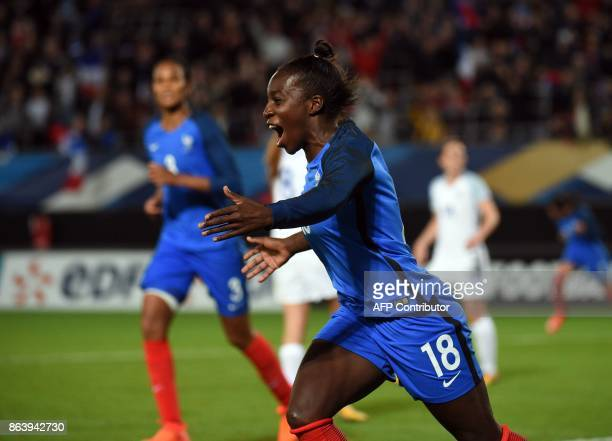 rance's Viviane Asseyi celebrates after scoring during the friendly football match between France and England at the Hainaut Stadium in Valenciennes...