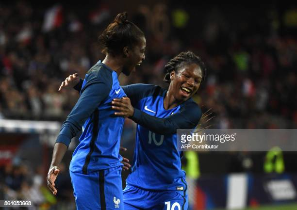 rance's Viviane Asseyi celebrates with a teammate after scoring during the friendly football match between France and England at the Hainaut Stadium...